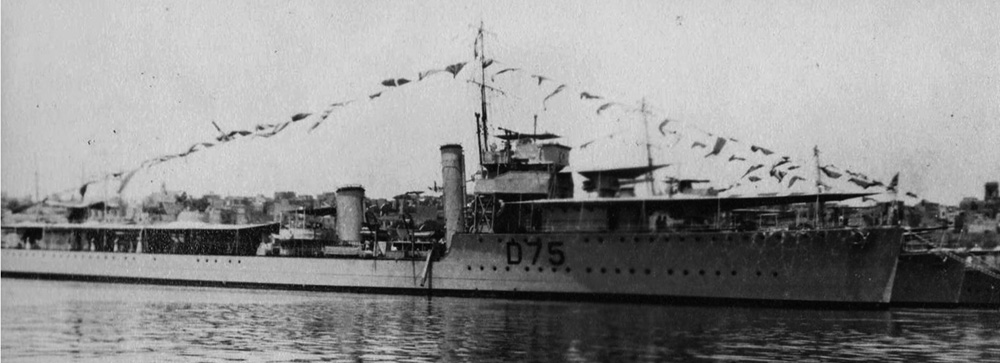 HMS Venous with awnings and flags in the Med, 1920s