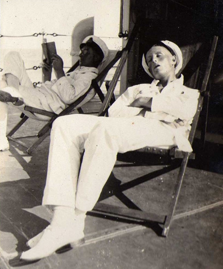 Chief and Sub Lt Colin G.W. Donald in deck chairs on HMS VEnomous