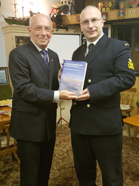 Rodgaard Presents Book to Sea Cadet atv Kings Lynne