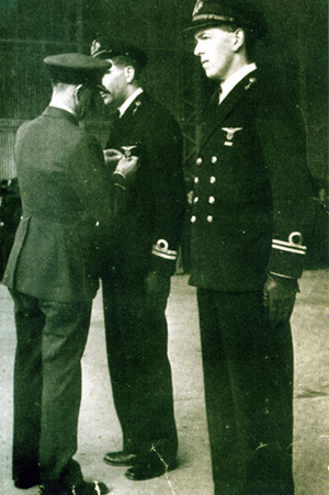 Jo Bongaerts being awarded the DFC by Air Marshall Sir Basil Embry, 12 February 1944