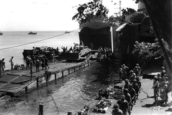 LST landing the Marine Brigade at Pasir Putih, East Java, 1947
