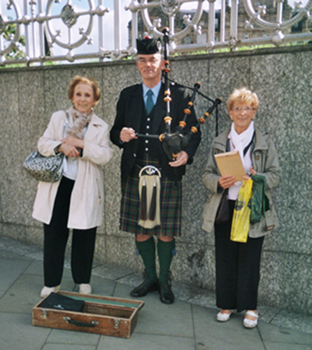 Posing with bagpipe player in Edinburgh