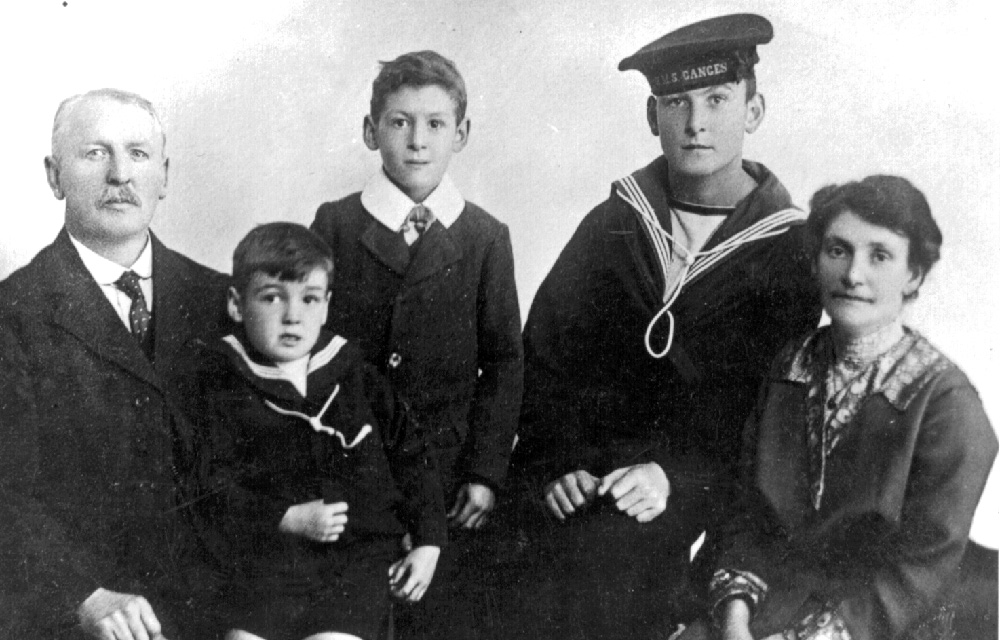 Reginal Williams with the cap ribbon of HMS Ganges with his family