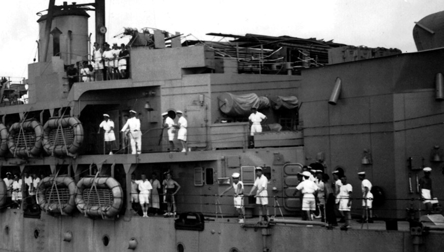 Officers and men lining the deck of HMS Hecla